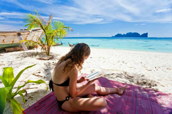 woman reading on Caribbean beach