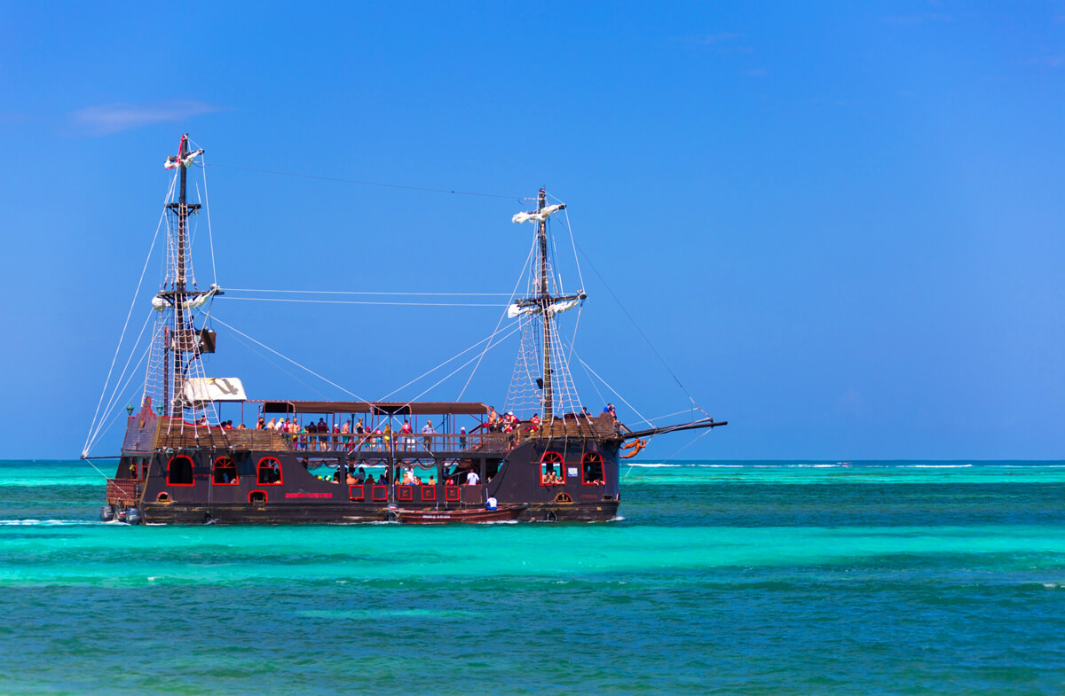 A pirate ship replica filled with adventurers