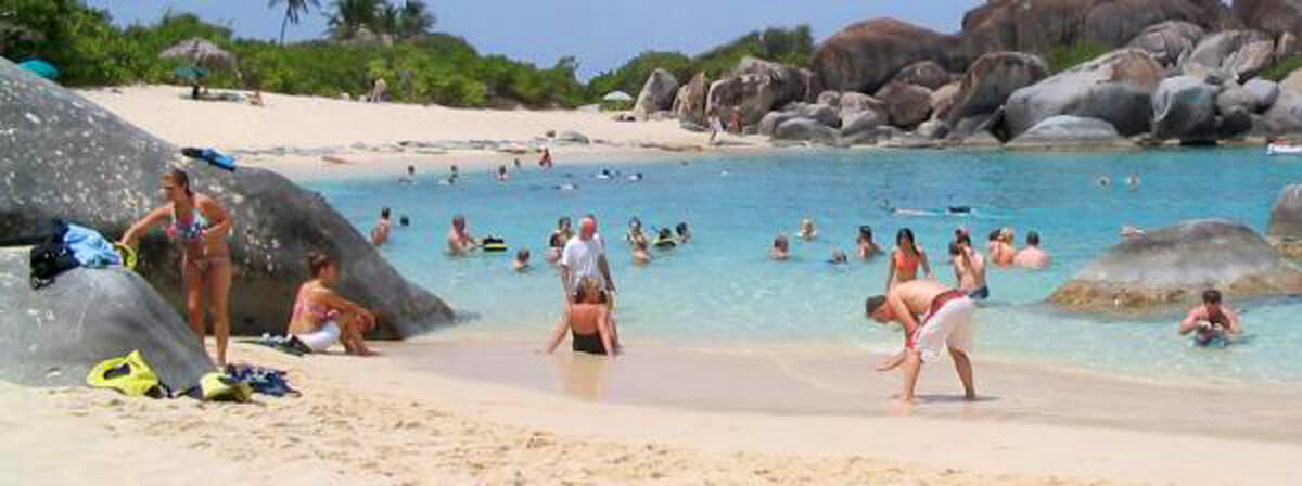 people playing on Virgin Gorda beach