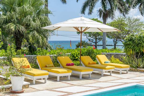 Lounge by the pool in the Jamaican sun at Retreat villa