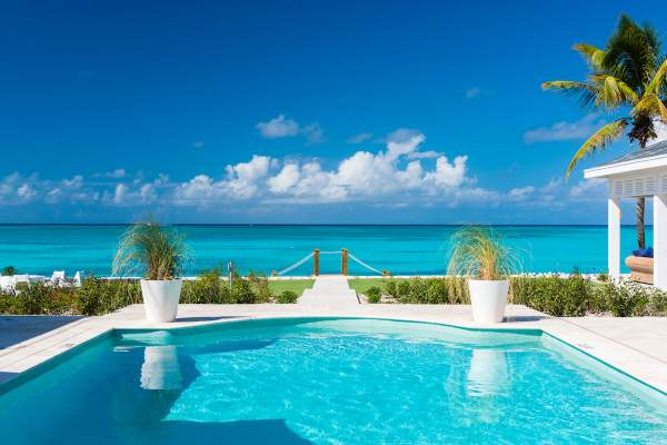 A luxurious pool just steps away from the beach at Milestone Villa