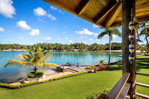 Casa de Campo #2306 has a beautiful lush lawn and private sun dock on the water