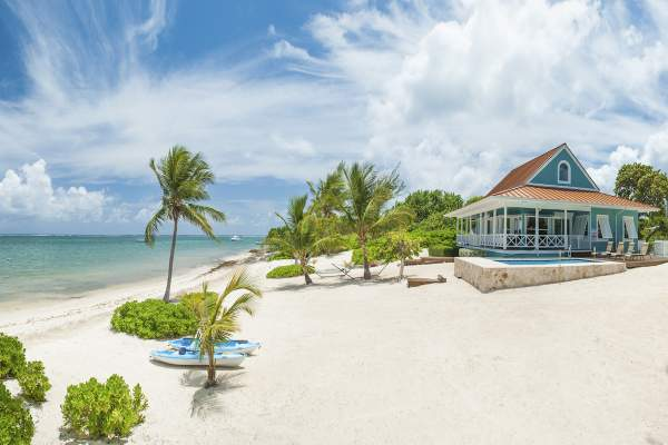 Lone Palm Villa is located on a beautiful white sand beach
