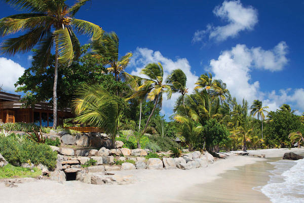 The beach front at the Beach Bungalows on Calivigny Island