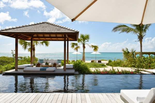 A private cabana sits beachfront at Love Pumpkin
