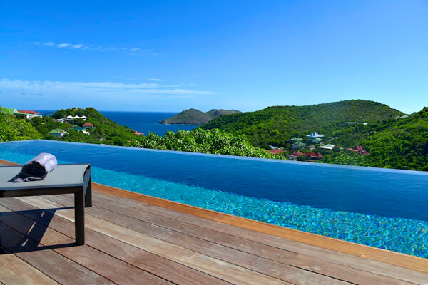 Alpaka Villa has beautiful views from its hillside location over Flamands Beach