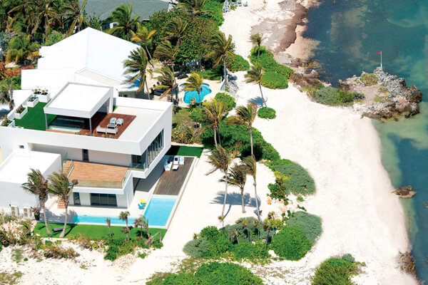 An aerial view of Olympus Villa and the beautiful beachfront