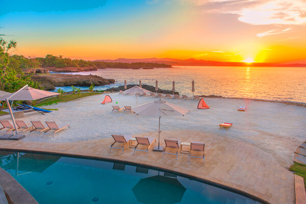 Enjoy amazing sunsets from the beach at the Amber Villa