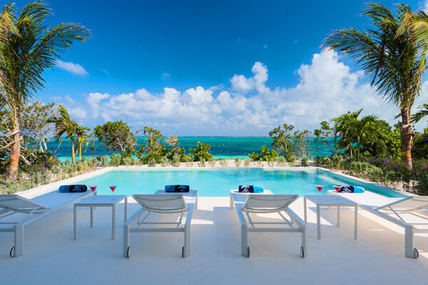 At Sandcastle you can lounge by the pool and enjoy the beautiful Caribbean ocean at the same time