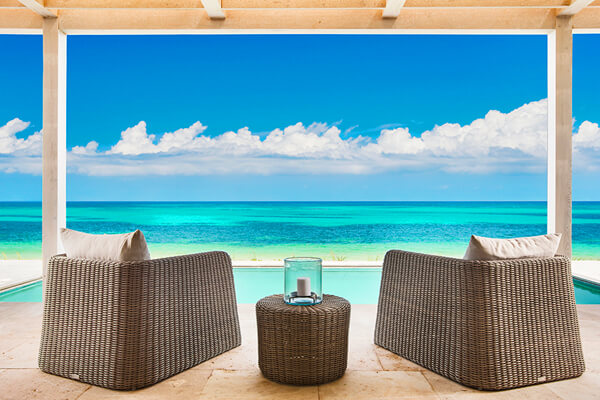 Enjoy endless ocean views from the patio at Sailrock Resort Beach Fron Villa 2 bedroom