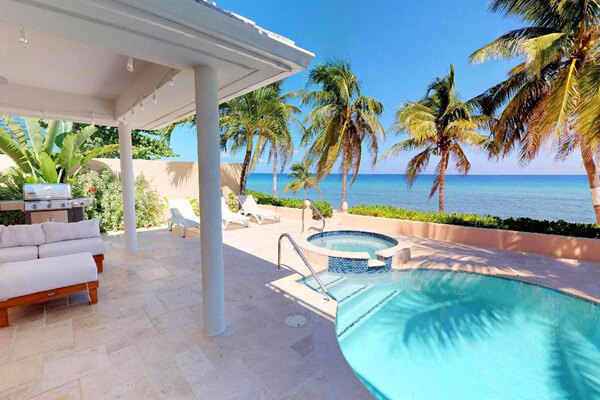 Conch Pointe Villa is located on the beach just minutes from Seven Mile Beach Corridor