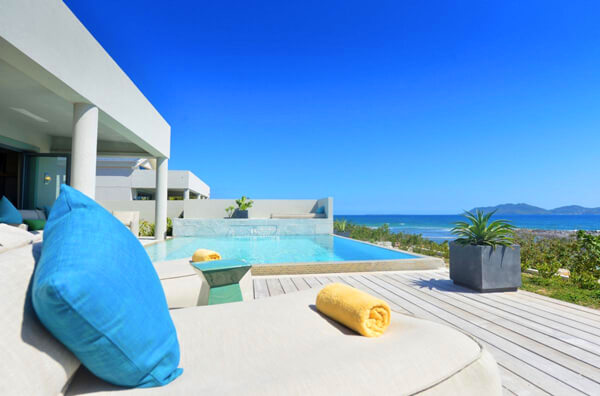 Solaire Villas are located on Pelican Bay with a beautiful stretch of sandy beach