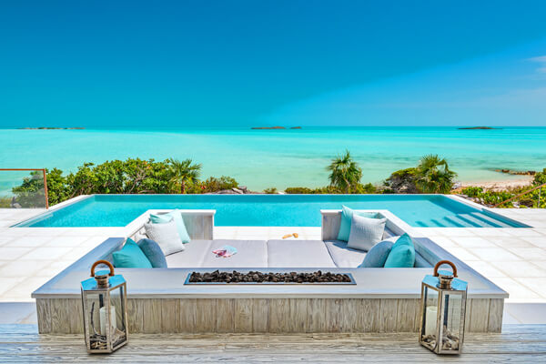 The pool at Bristol Bliss sits beachside overlooking the azure waters so famous in Turks and Caicos