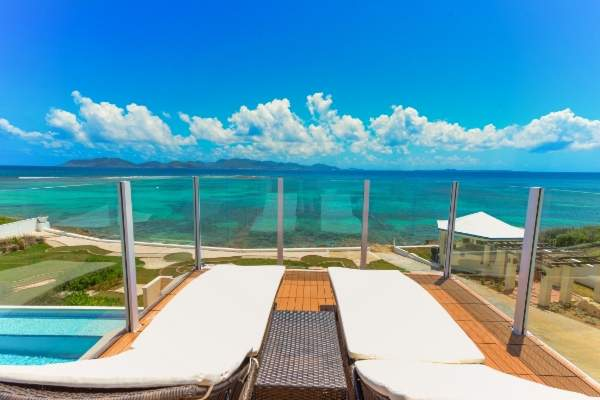 Lounge on a balcony patio over looking the ocean from Anguillitta Villa