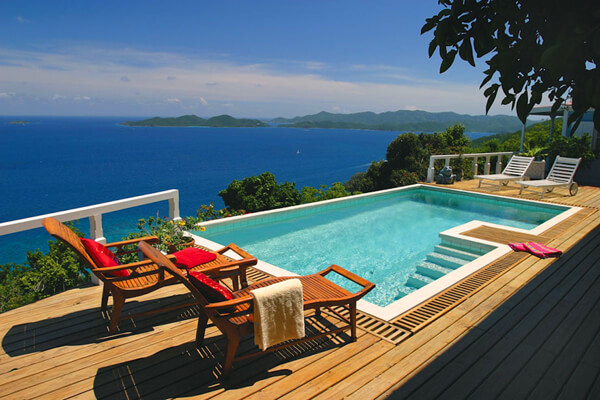 Lounge in the sun and enjoy Caribbean views from the pool deck at Toa Toa House
