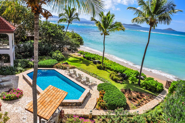 From the balcony at Caribbean Wind Villa you have  beautiful views of the pool and the ocean