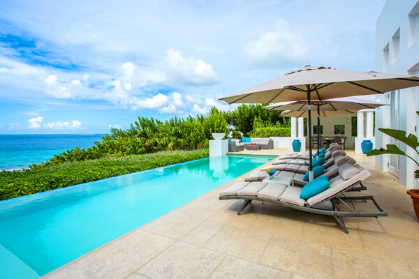 Lounge in luxury at Sand Villa on Long Bay Beach