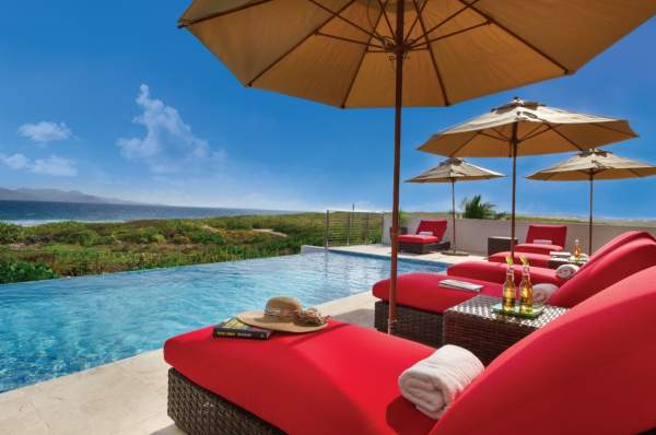 Lounge poolside with amazing views of the ocean