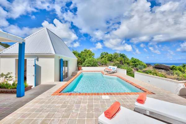 Pool area has great views at VEL Villa