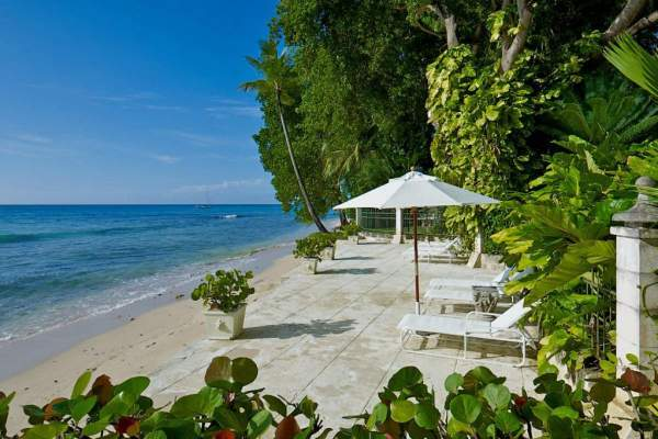 Mango Bay\'s patio sits right on the beach