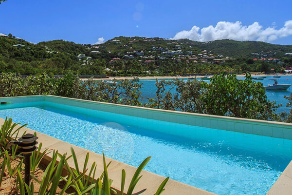 Sous La Falaise Villa sits above the edge of beautiful St. Jean Bay