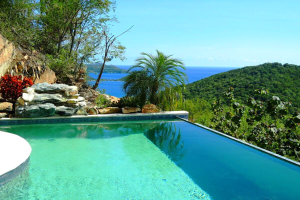 Coral Harbor boasts a beautiful hillside infinity edge pool