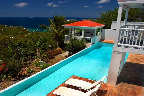 Lounge on the deck poolside and enjoy views of the Caribbean