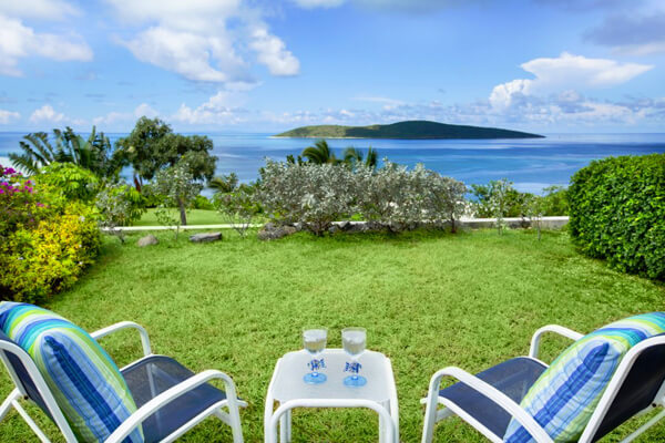 Relax on the lawn at Caribbean Pearl Villa and enjoy great ocean views