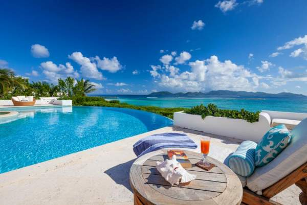 The beautiful pool and Caribbean views from Alegria Villa