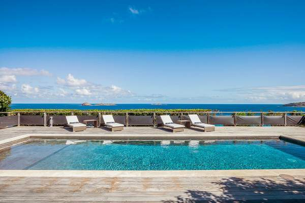 Lounge poolside and enjoy amazing ocean views from Claridge Villa