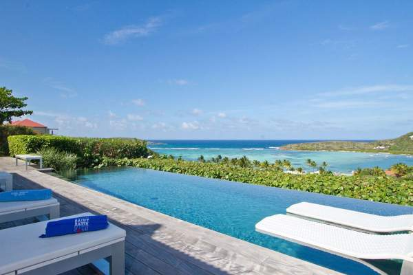 The infinity edge pool and patio deck overlook Grand-cul-de-sac