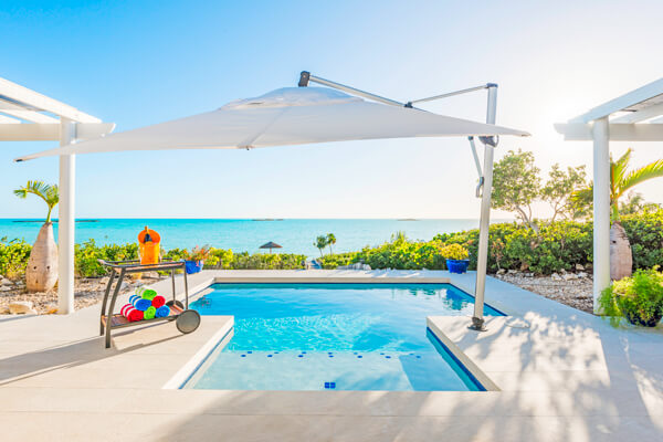 Sandy Shore Villa is located on the beach of the beautiful Taylor Bay