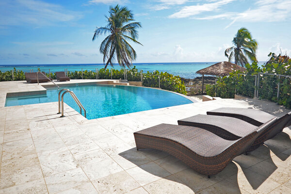 Lounge poolside on the beach at Pease Bay House