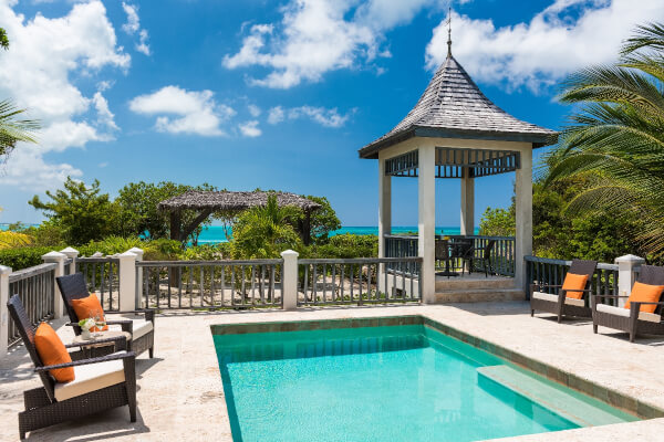 Ballyhoo Cottage sits on Grace Bay Beach