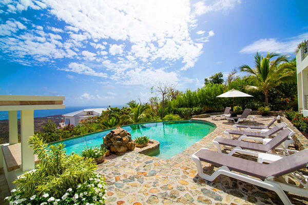 Victoria Villa is located in the Oyster Pond neighborhood on a hillside overlooking Orient Bay