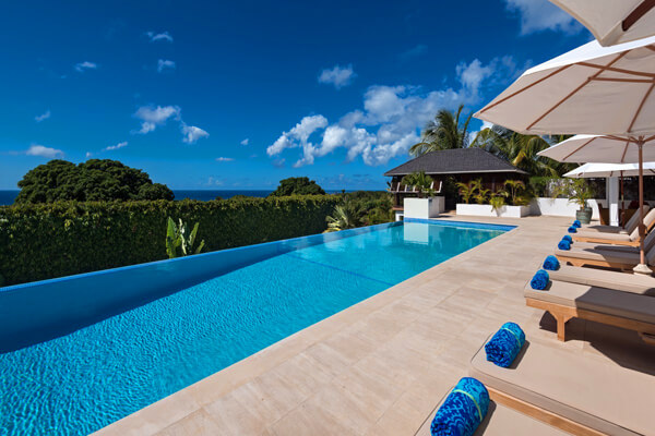 Tom Tom Villa is located in the heart of Royal Westmoreland and features an infinity edge pool