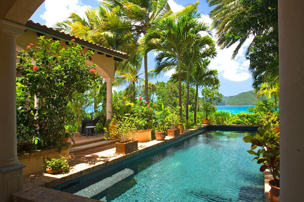 The private pool at The Beach House surrounded in tropical beauty