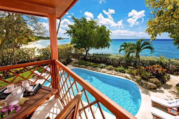 A private beachside pool offers relaxation at Blue Point Villa