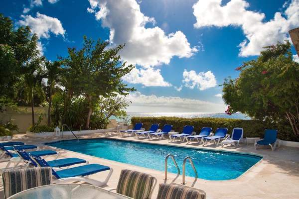 Private beachside pool with plenty of lounging at Oyster Bay villa