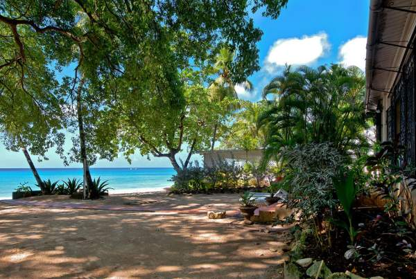 Nestled among the trees on Mullins beach Whitecaps villa offers plenty of privacy