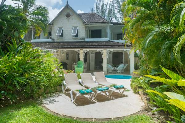 Waverly House is tucked into lush tropical greenery just along Gibbs Beach