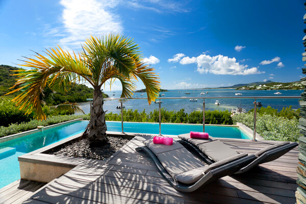 Relax on the deck and watch the ocean traffic in the Bay at Pinel Villa