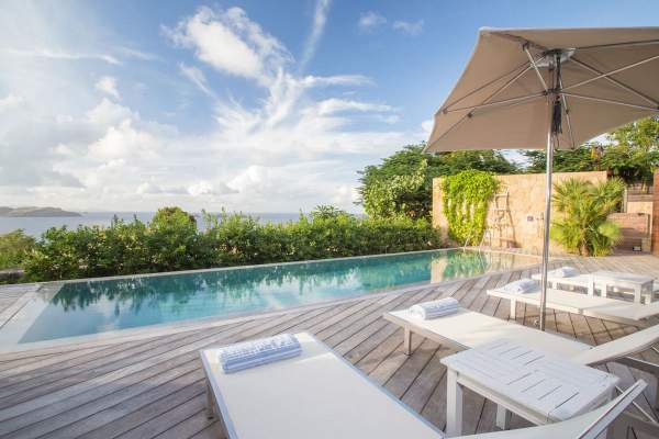 Lounge by the pool at Marie Villa and enjoy views of the ocean
