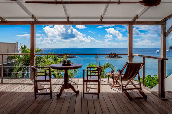 Relax and enjoy views of the Ocean from the deck at Gustavia Hill Villa