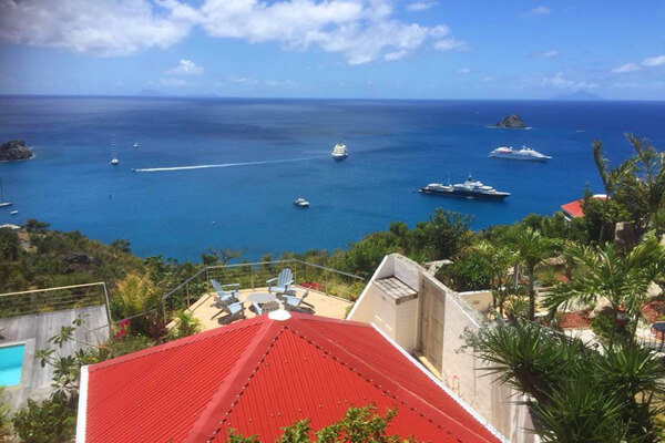 An aerial shot from above La Baleine Villa shows off views of Gustavia Harbor