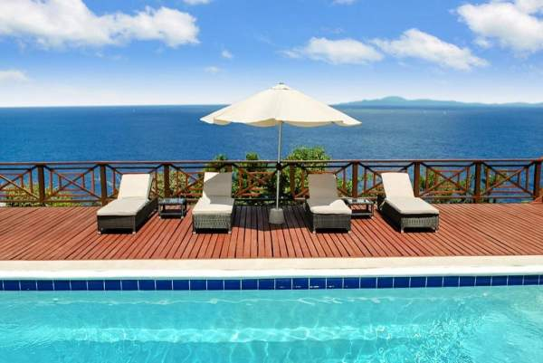 Lounge by the pool with the ocean as your background at Panorama