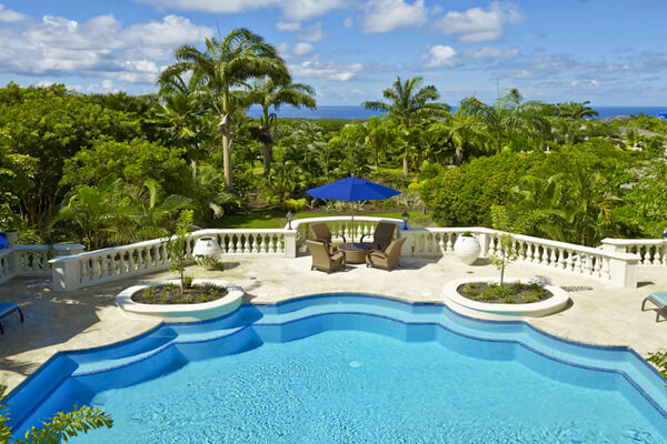 Grand views of the pool and the ocean beyond from the balcony at Plantation House