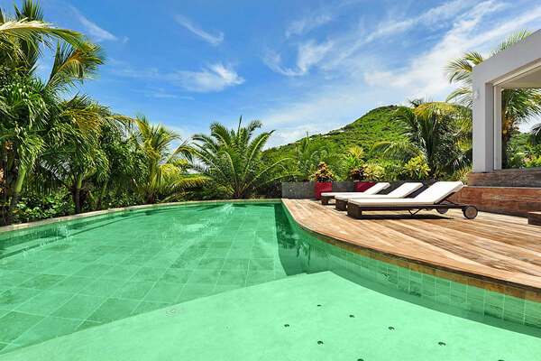 Villa Murraya and the pool are surrounded by lush tropical greenery