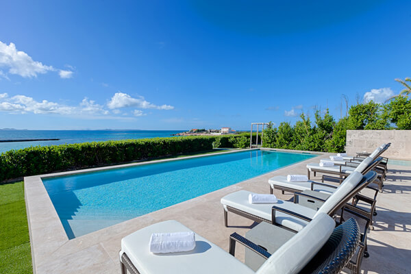 Lounge by the pool and enjoy amazing ocean views at Beaches Edge East Villa