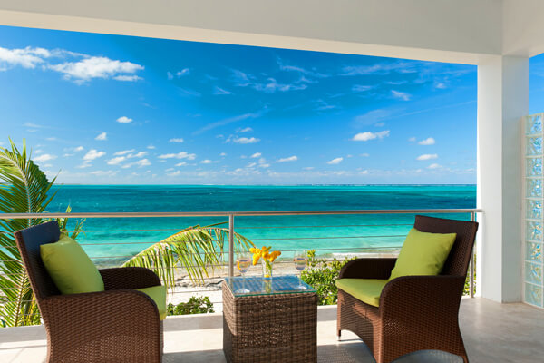 Endless Caribbean views form the patio balcony at Sea Edge Villa